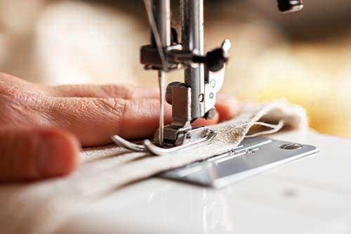 Handarbeit spielt bei Dolzer Maßkonfektionäre eine große Rolle